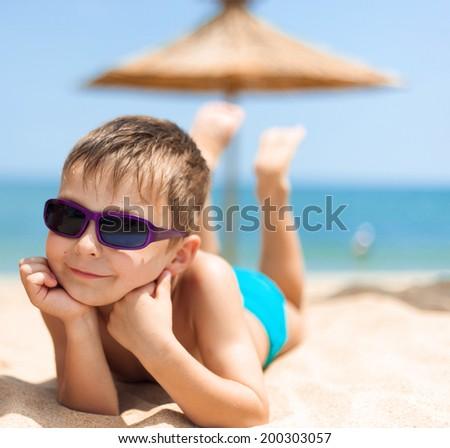 Portrait of boy on the beach - stock photo