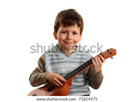 Portrait of  boy practicing playing guitar isolated on white background - stock photo