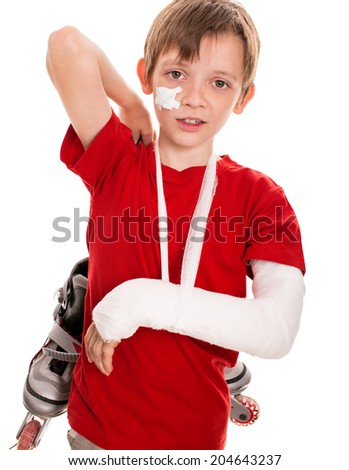 portrait of boy with a broken arm holding roller skates, isolated over white - stock photo