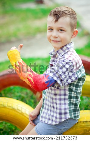 Portrait of boy with a broken arm on the outdoor - stock photo