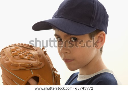 Portrait of boy with baseball mitt - stock photo
