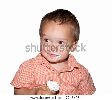 portrait of boy with his mouth smeared with ice cream on white background - stock photo