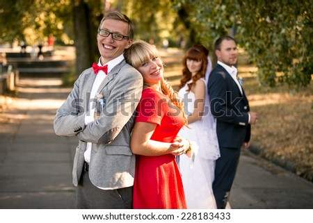 Portrait of bridesmaid and groomsman on wedding at park - stock photo