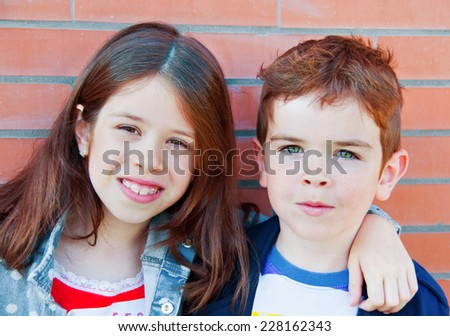 Portrait of brother and sister - stock photo
