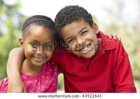 Portrait Of Brother And Sister In Park - stock photo