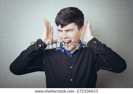 portrait of brunette man screams hysterically - stock photo