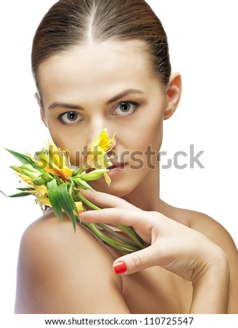 portrait of brunette spa woman with flower - stock photo