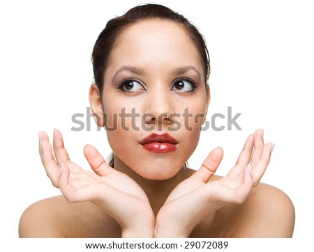 portrait of brunette woman with brown eyes holding her arms up next to her chin - stock photo