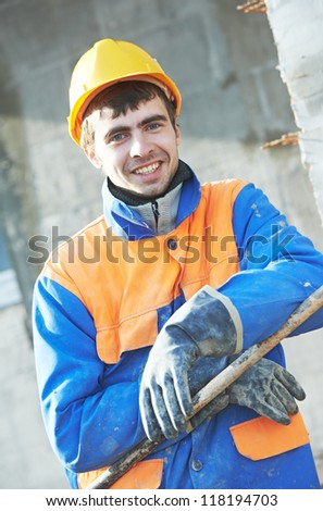 Portrait of builder worker industrial plasterer - stock photo