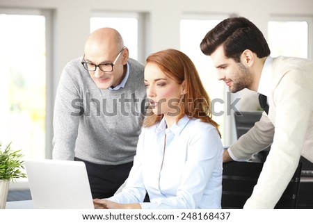 Portrait of business colleagues working on laptop. Teamwork at office.  - stock photo