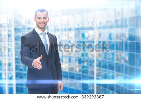 Portrait of business man handshake gesturing, blue background. Concept of leadership and success - stock photo
