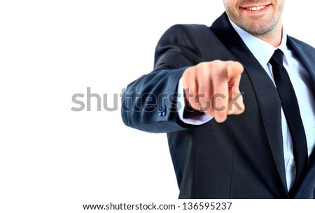 Portrait of business man pointing at you against white background - stock photo