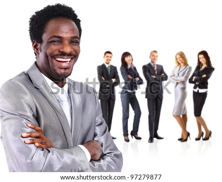Portrait of business man standing together with colleagues and smiling - stock photo