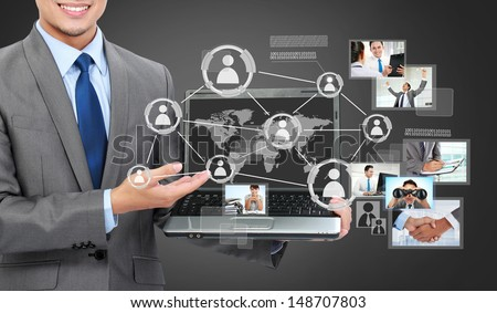 Portrait of business man with laptop showing social connected on a virtual background - stock photo