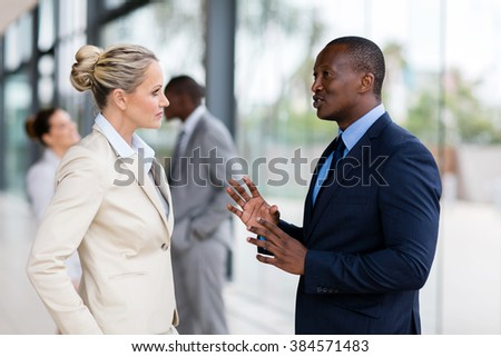 portrait of business people chatting after the meeting - stock photo