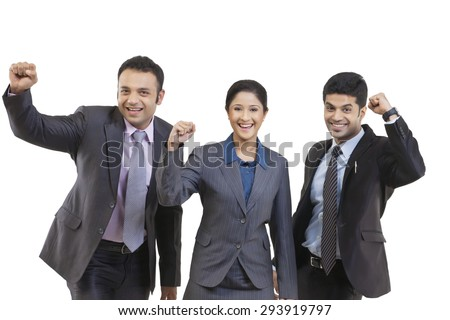 Portrait of business people cheering - stock photo