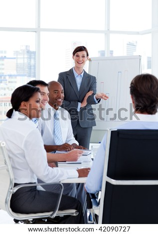 Portrait of business people discussing a new strategy at a meeting - stock photo