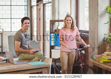 Portrait of business people in creative bright office - stock photo