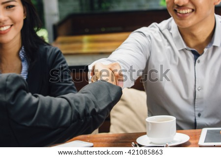 portrait of Business people shaking hands while meeting at the office - stock photo