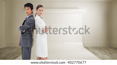 Portrait of business people standing back-to-back against large white screen - stock photo
