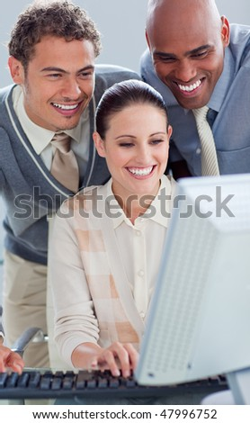 Portrait of business people working at a computer in the office - stock photo