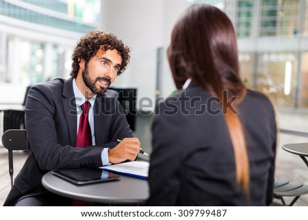 Portrait of business people working on some documents - stock photo