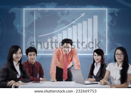 Portrait of business team looking and smiling on camera in the business meeting - stock photo