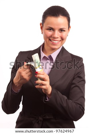portrait of business woman showing bundle of money isolated on white - stock photo