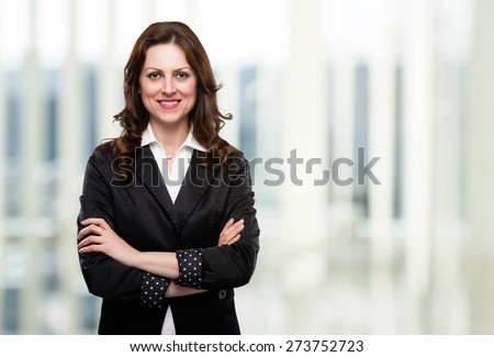 Portrait of business woman smiling in her office. - stock photo