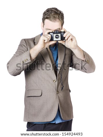 Portrait Of Businessman Capturing Photos With Vintage Camera On White Camera - stock photo