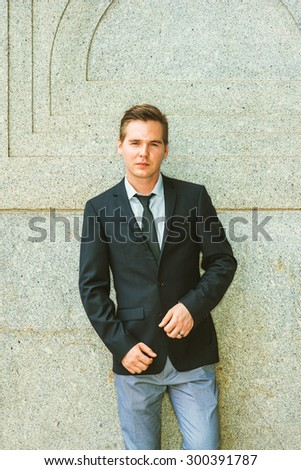 Portrait of Businessman. Dressing in black suit, tie, gray pants, a young professional standing against vintage style of wall, looking at you, confident, believing and success. Instagram effect. - stock photo