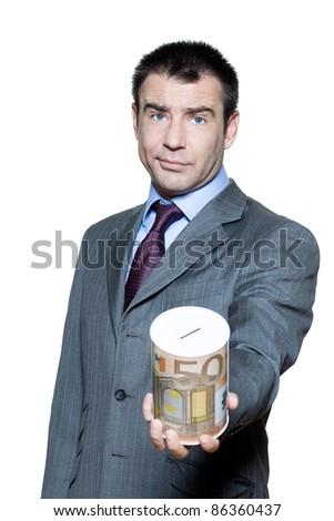 Portrait of businessman holding money box begging for money in studio on isolated white background - stock photo