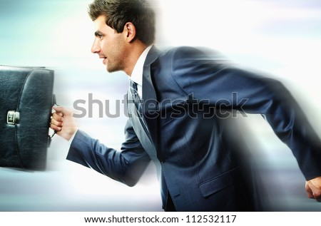 Portrait of businessman hurrying somewhere - stock photo