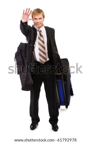 portrait of businessman in suit with bags waving hand in greeting - stock photo