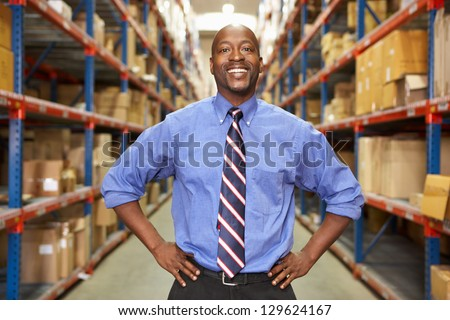 Portrait Of Businessman In Warehouse - stock photo