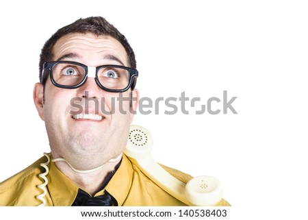 Portrait of businessman in yellow shirt and dark tie with cable of a telephone  round his neck exhausted by working under stress isolated on white background - stock photo