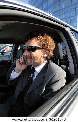 Portrait of businessman inside the car - stock photo