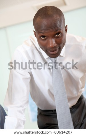 Portrait of businessman looking at camera - stock photo