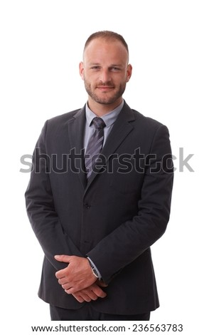 Portrait of businessman over white background, wearing suit, looking at camera. - stock photo