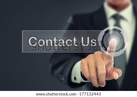 portrait of Businessman push to  Contact Us button on virtual screen - stock photo