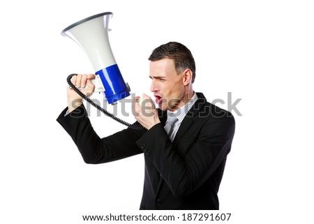 Portrait of businessman shouting through megaphone isolated on white background - stock photo