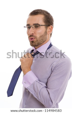 Portrait of businessman showing a relief attitude after loosening his necktie. - stock photo