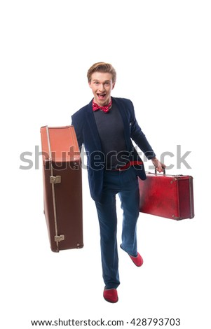 Portrait of Businessman sitting on his suitcase while and smile - stock photo