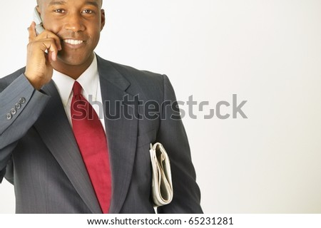 Portrait of businessman talking on cell phone - stock photo