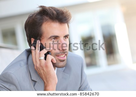 Portrait of businessman talking on the phone - stock photo