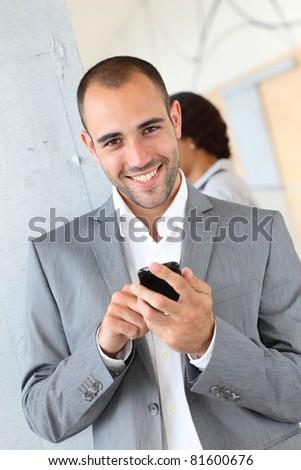 Portrait of businessman using mobile phone - stock photo