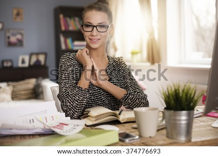 Portrait of businesswoman at her office - stock photo