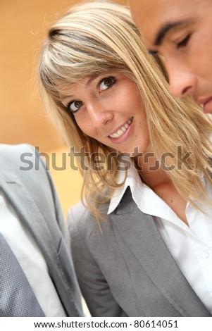 Portrait of businesswoman meeting sales people - stock photo