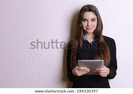 Portrait of businesswoman near wall - stock photo