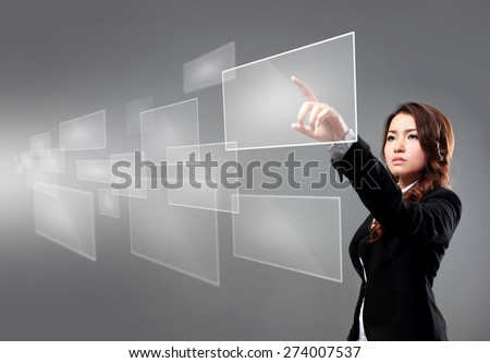 portrait of businesswoman pointing at floating screen using high technology - stock photo